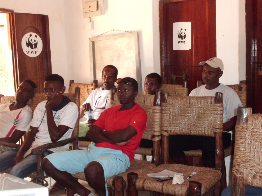 WWF Kiunga staff in their workshop, conference and training room.