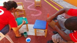 Nadia and fellow volunteer Landon helping renovate the Special Needs School