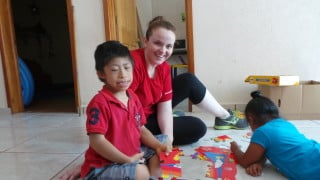 Mary hanging with Juan at the Special Needs School