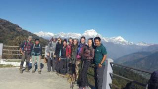 Volunteers enjoying the beautiful view from Poon Hill