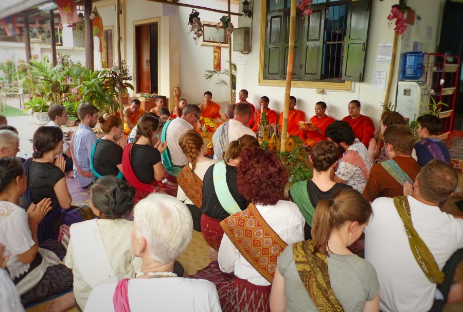 Volunteers participating in a religious Basci cermony, whereby Novices and Monks bless the building to rid it of bad spirits for the new year.