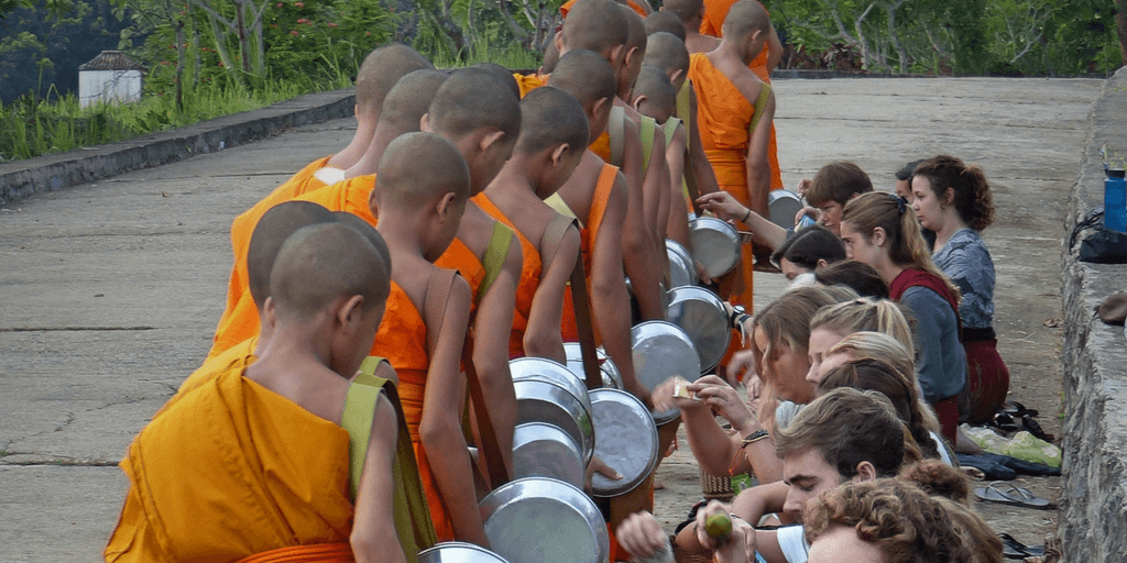 volunteer with buddhist monks in laos, asia