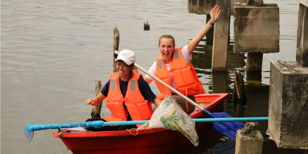GVI volunteers participate in a lake clean up in Phang Nga, Thailand