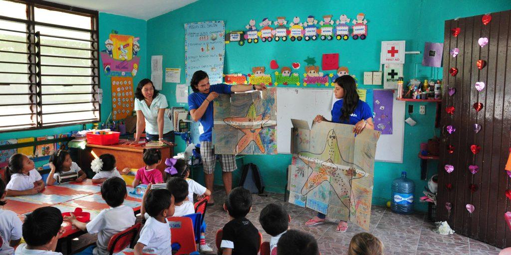 GVI participants teach the children about the ocean animals.
