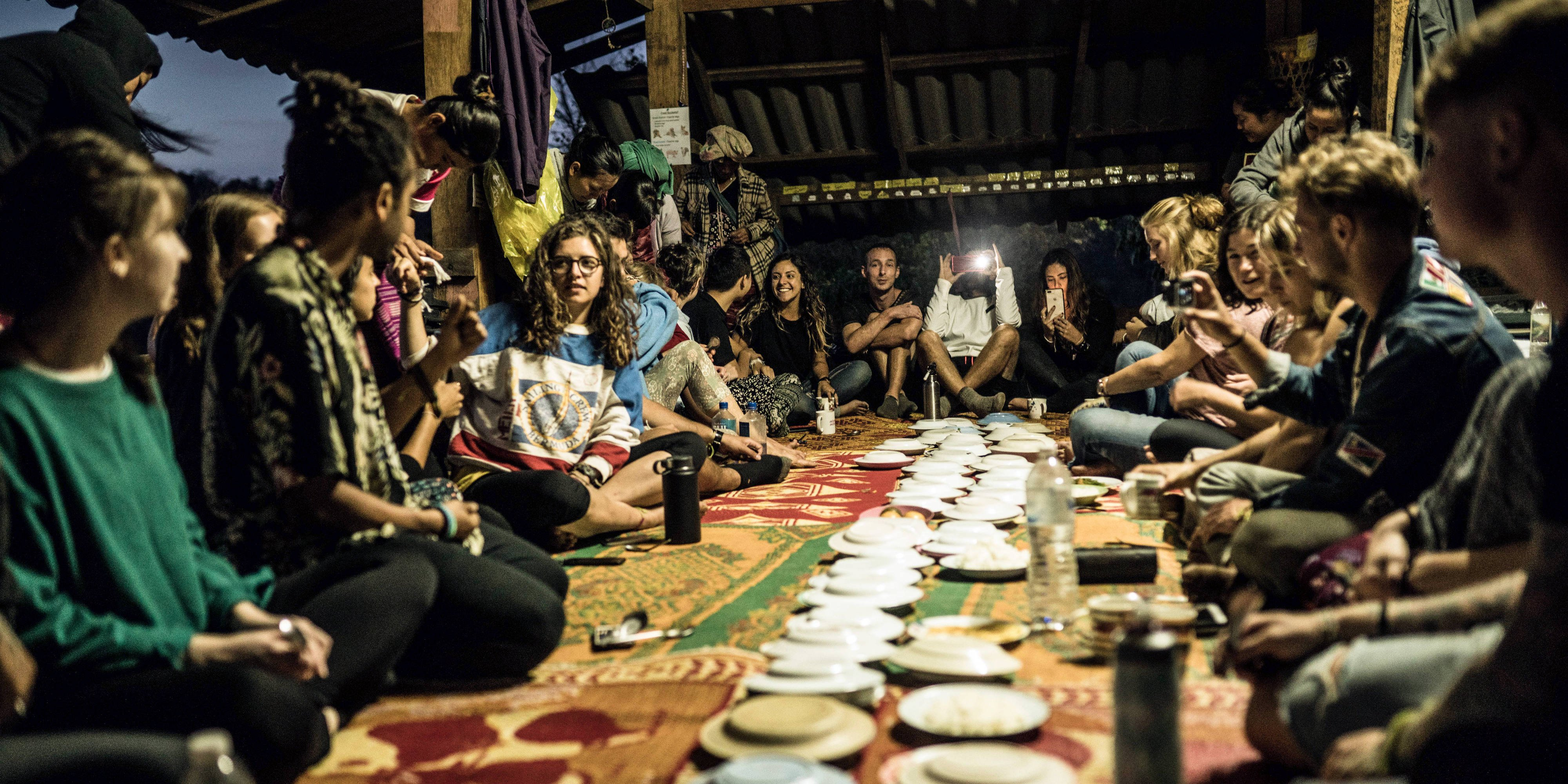 GVI participants share a communal meal in Chiang Mai, while on the program working with elephants in Thailand.