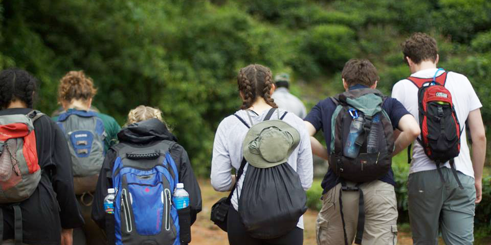 Wondering what to pack for a school trip abroad? These teen volunteers are well-organised with hats, backpacks and hiking shoes.