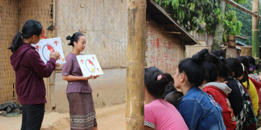 Local women lead a session on menstrual health education in Laos