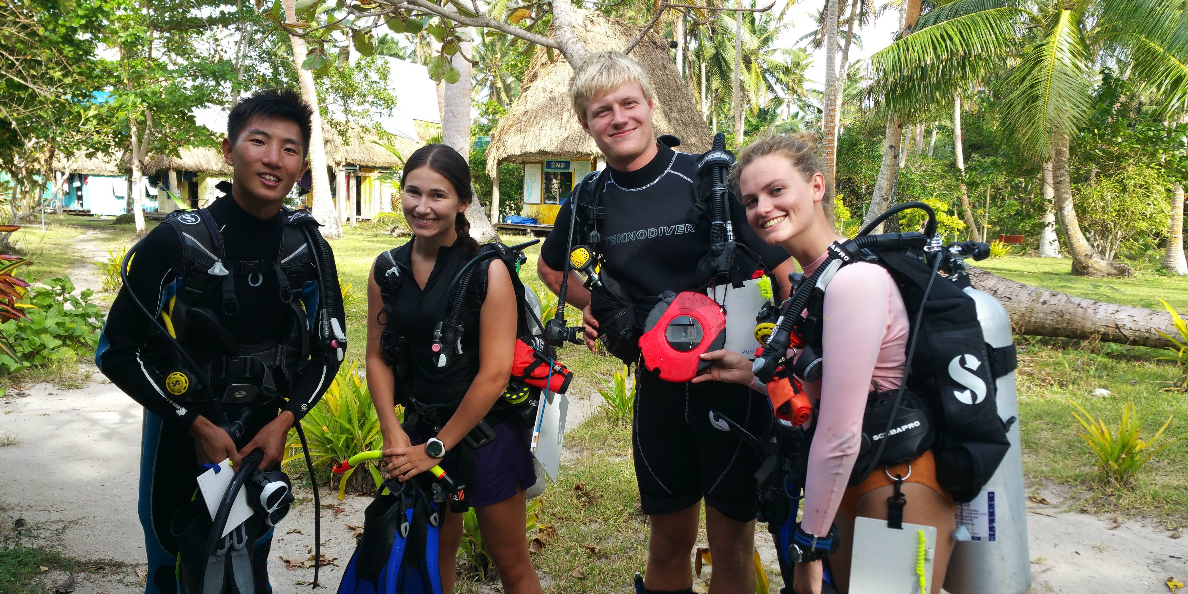 GVI participants in Caqalai prepare to set out on an open water dive. These dives count toward their PADI certifications.