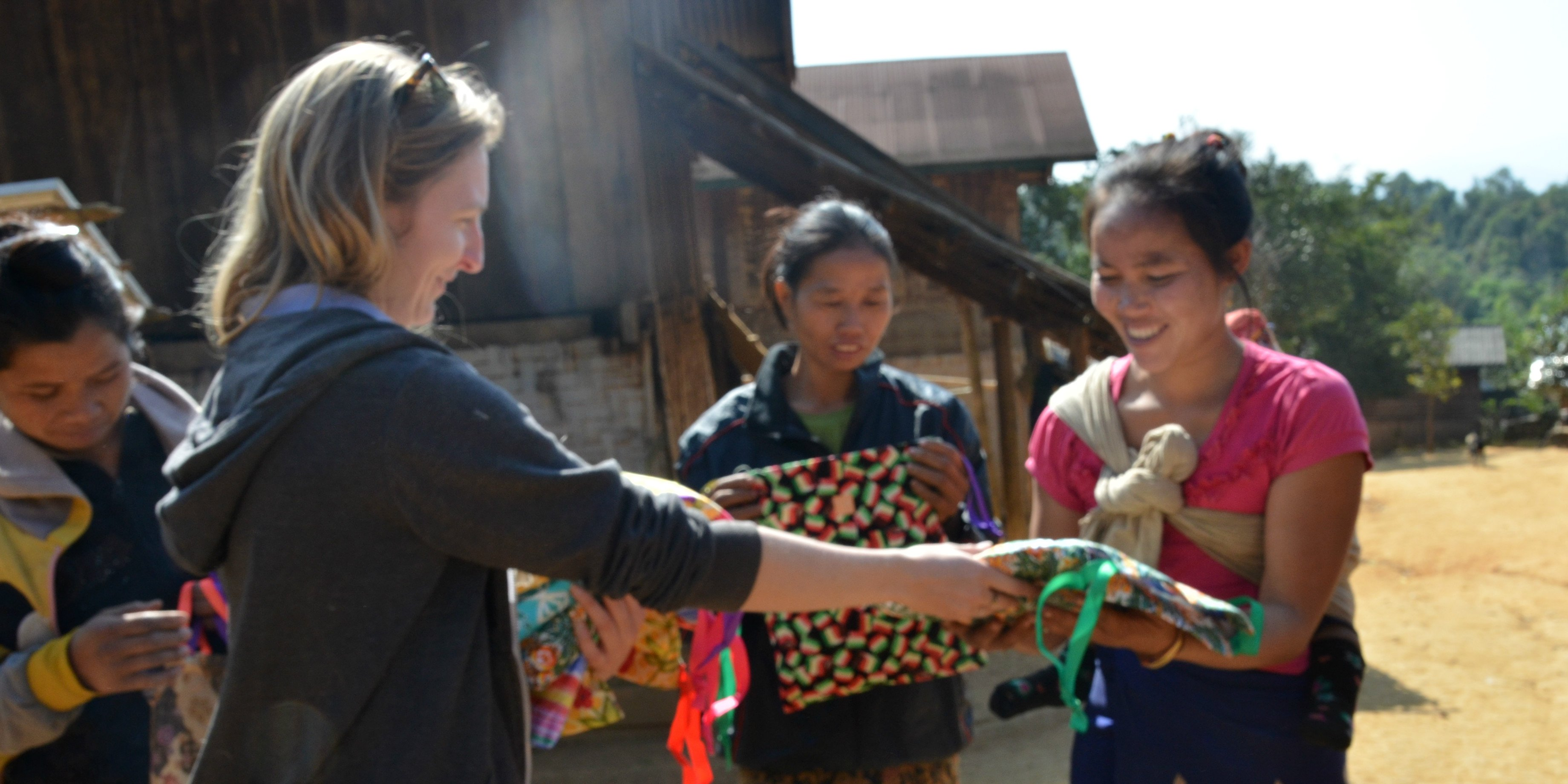 A GVI participant helps disseminate Days for Girls menstrual health kit at a menstrual health workshop.