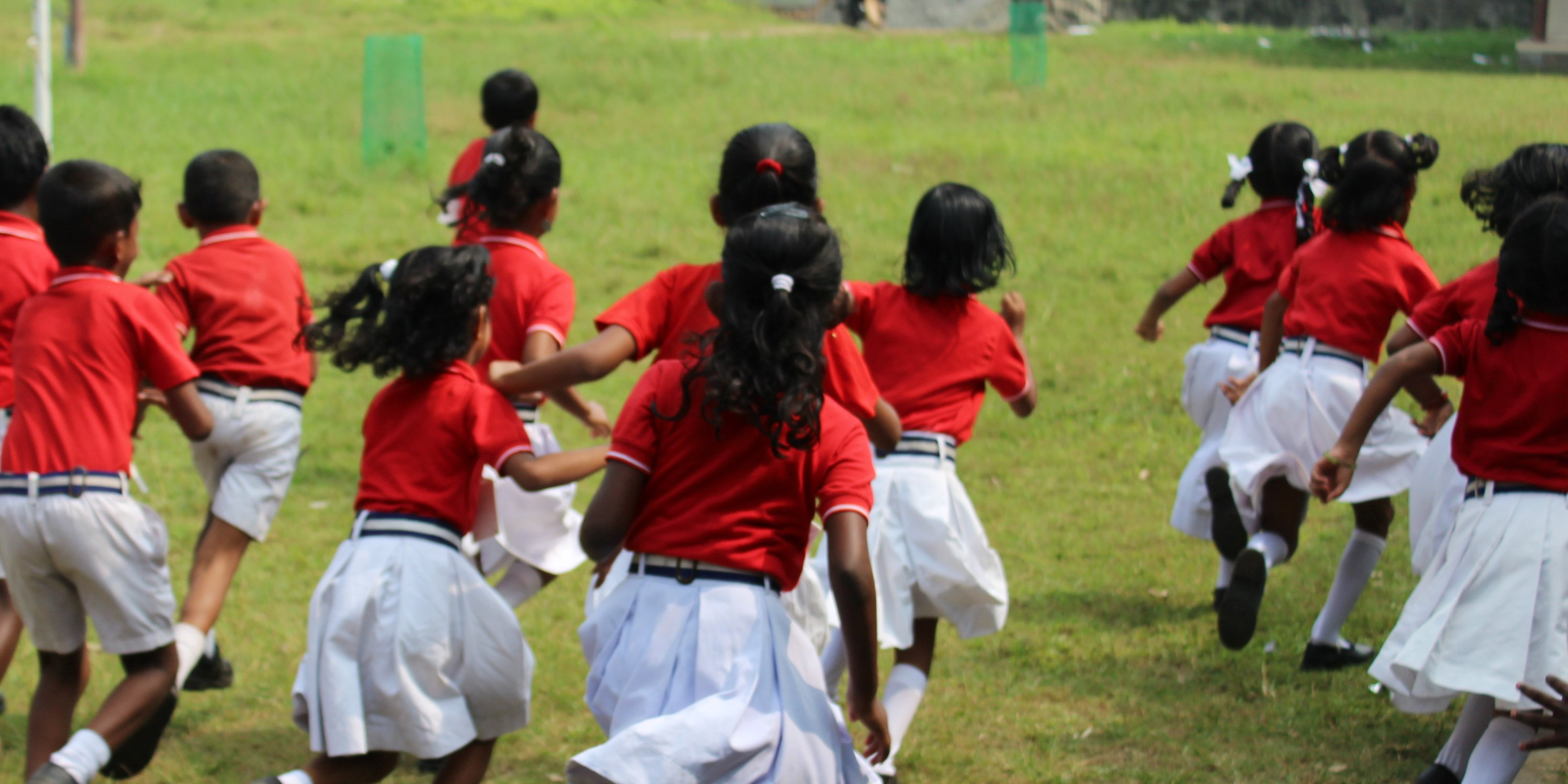Schoolchildren take part in a sports program with GVI participants who are volunteering in India.
