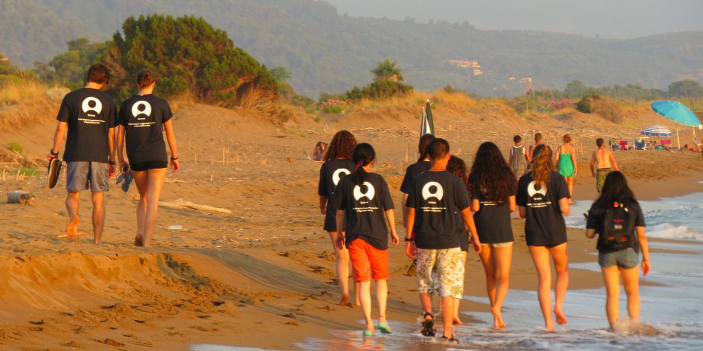 GVI participants walking home during the beach sunset, after a day of volunteering