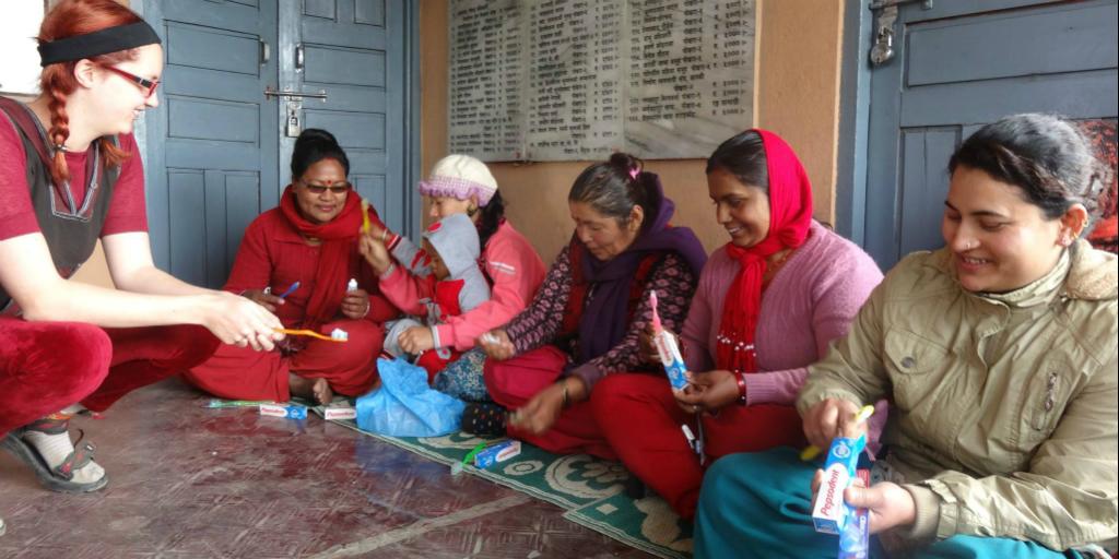 Volunteers teaching women about hygiene practises in India