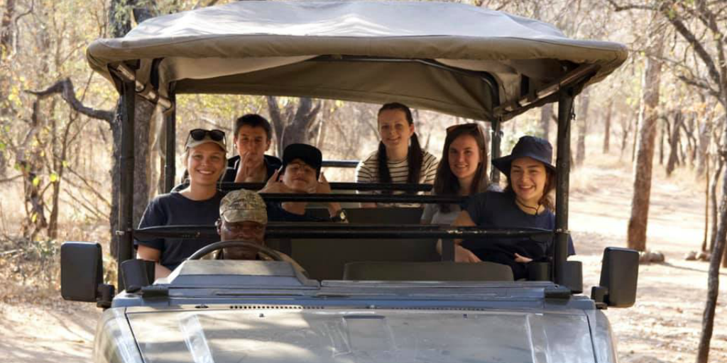 Wildlife volunteers on a safari in a safari jeep