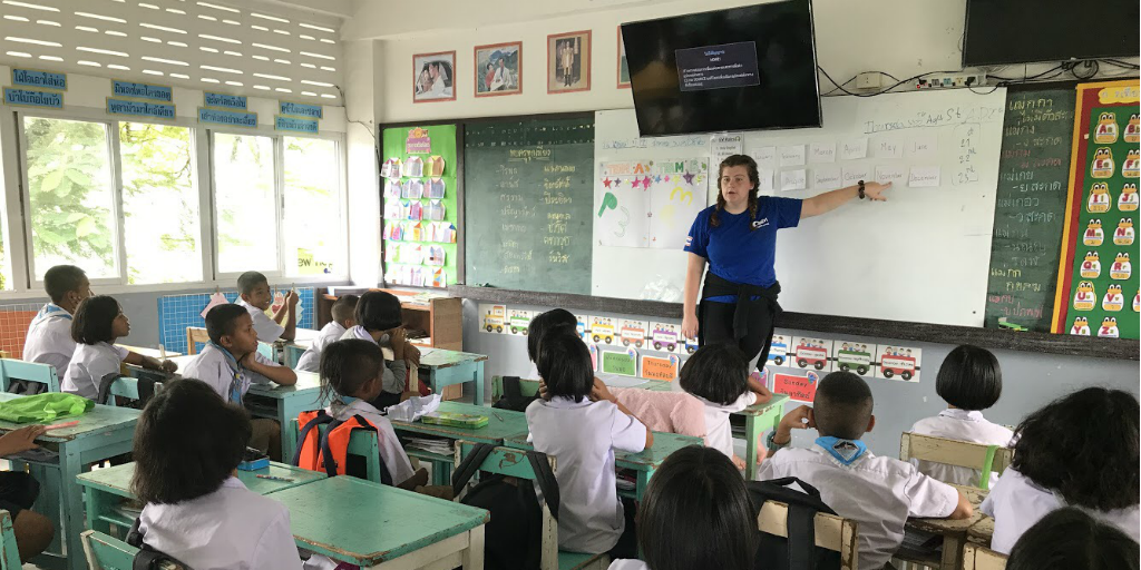 A volunteer teaching a class of children in Phang Nga, Thailand.