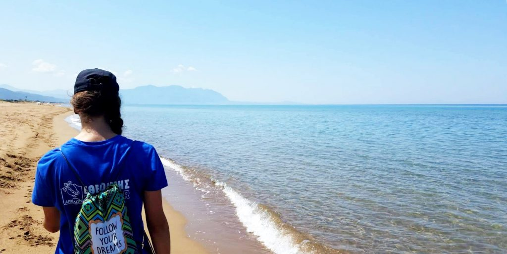 A participant walks along the beach while on a gap year program in Greece.