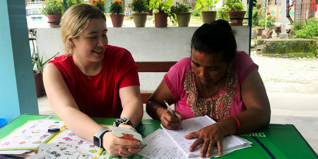 Volunteer teaching english while volunteering in Nepal.