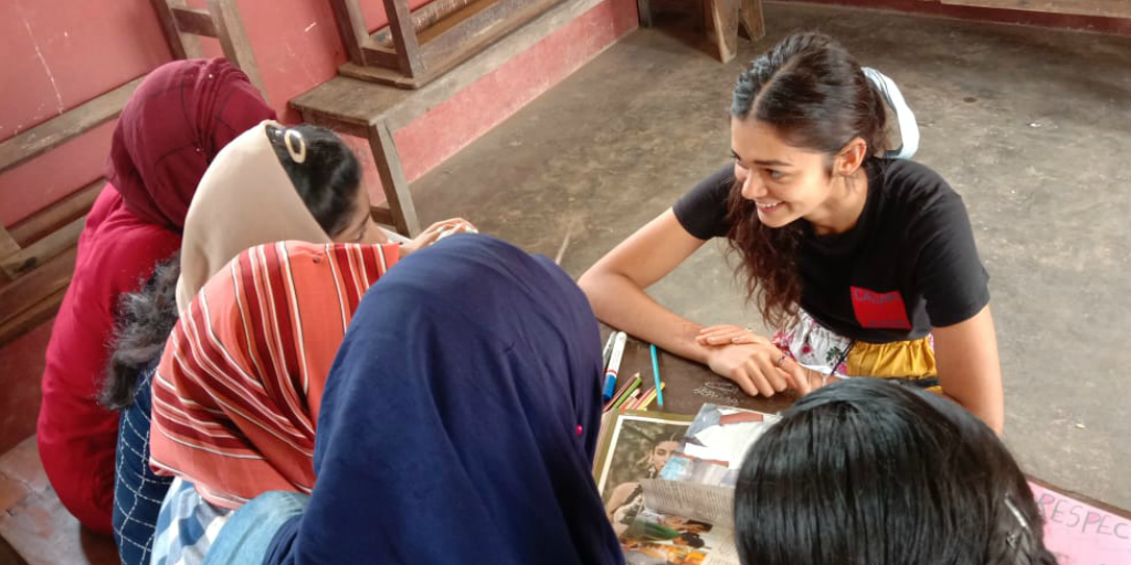 a volunteer in india working on a womens empowerment program