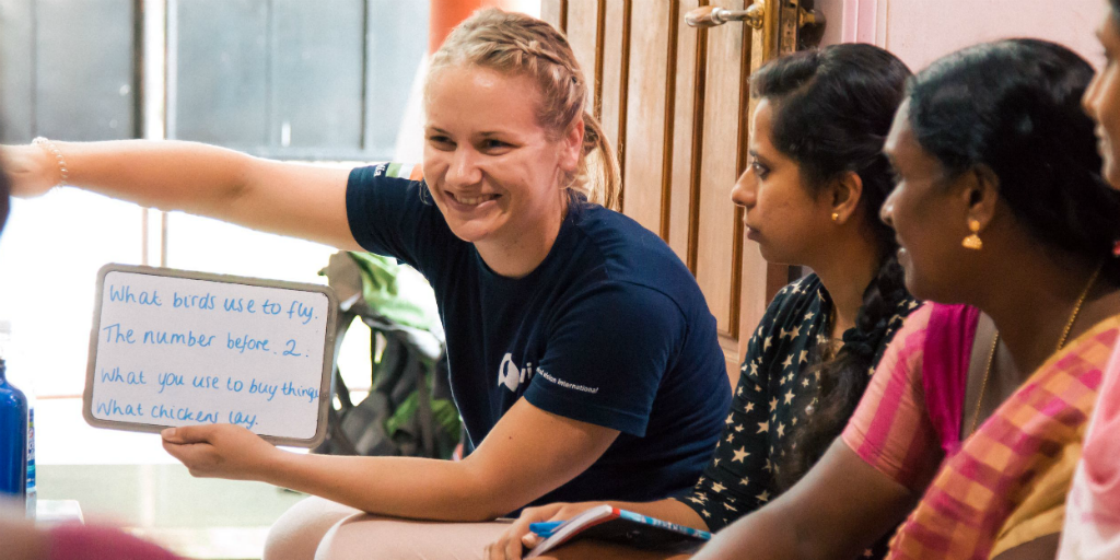 a volunteer in india teaching english on a womens empowerment program