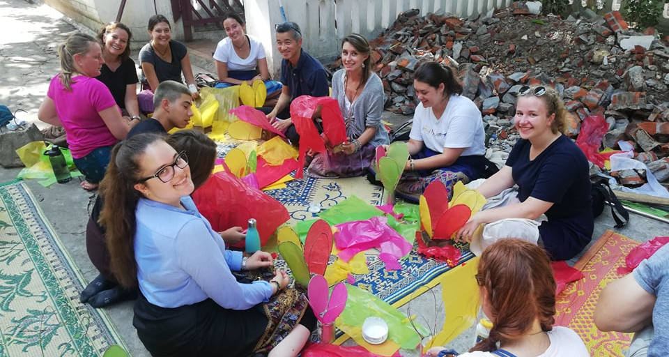 Participants in Laos crafting with locals