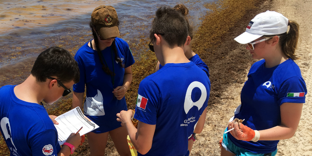 A group of participants fill in survey details while on one of GVI's gap year programs abroad.