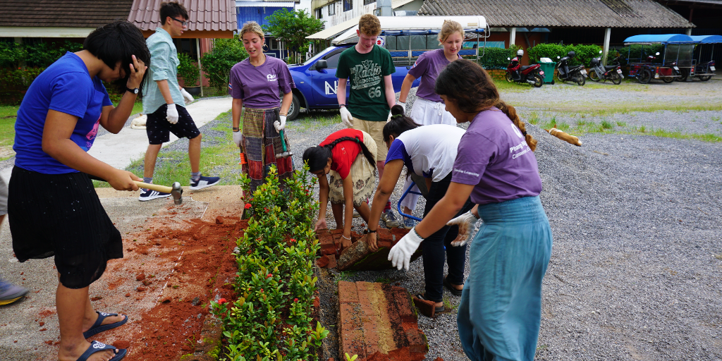 The GVI volunteers participate in an ecosystem restoration project by planting trees.