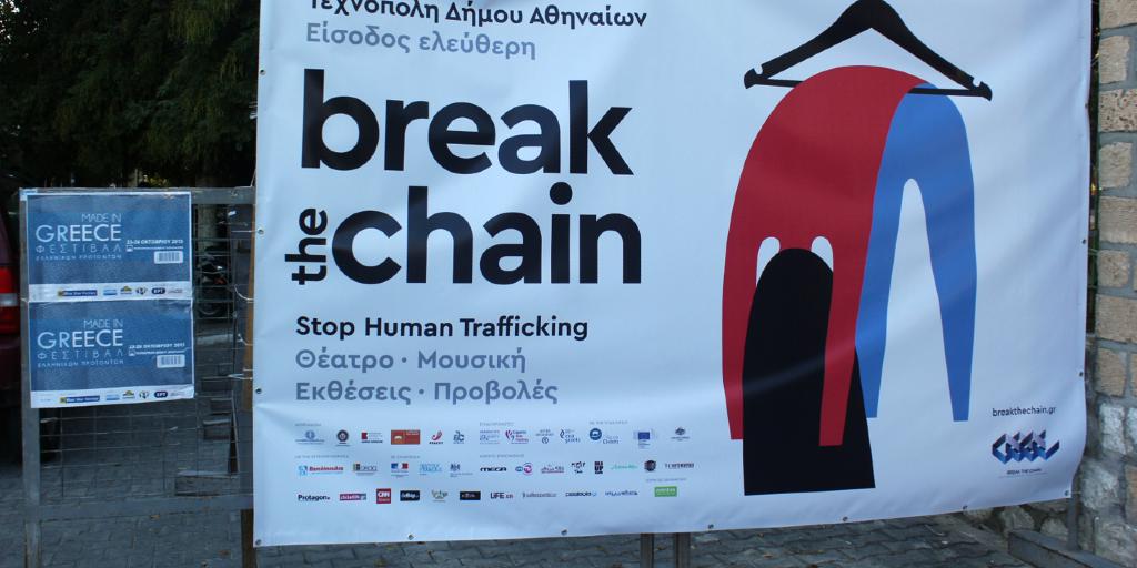 A human trafficking awareness banner in Greece.