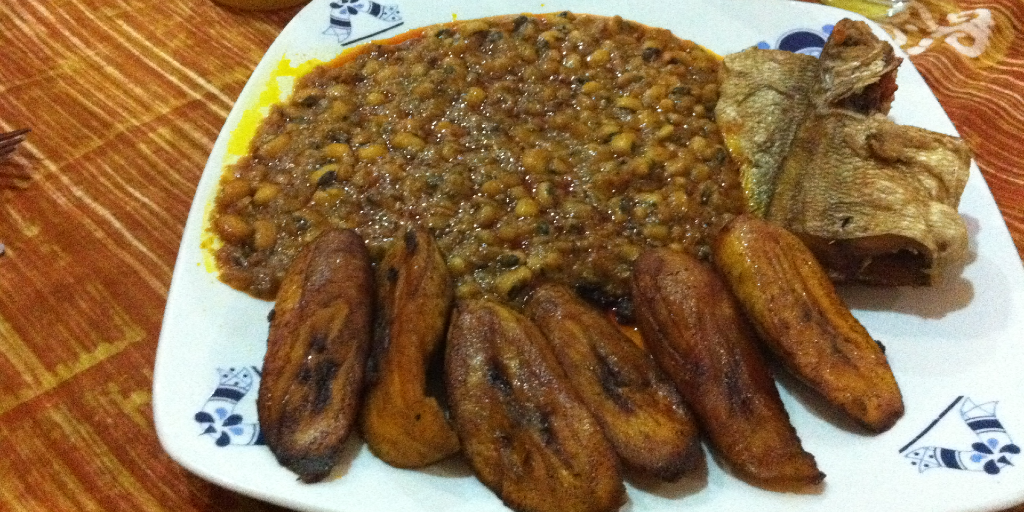 A plate of red red stew and fried plantain.