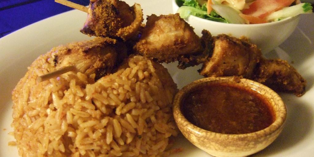 Ghanaian jollof rice with chicken kebabs.