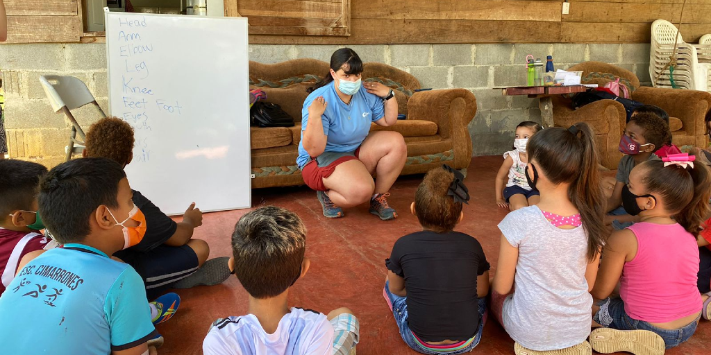 A gap year volunteer teaches the children about the body parts in Costa Rica.